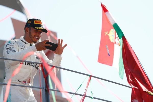 Autodromo Nazionale di Monza, Italy. Sunday 03 September 2017. Lewis Hamilton, Mercedes AMG, 1st Position, takes a photo from the podium. World Copyright: Glenn Dunbar/LAT Images  ref: Digital Image _X4I3753