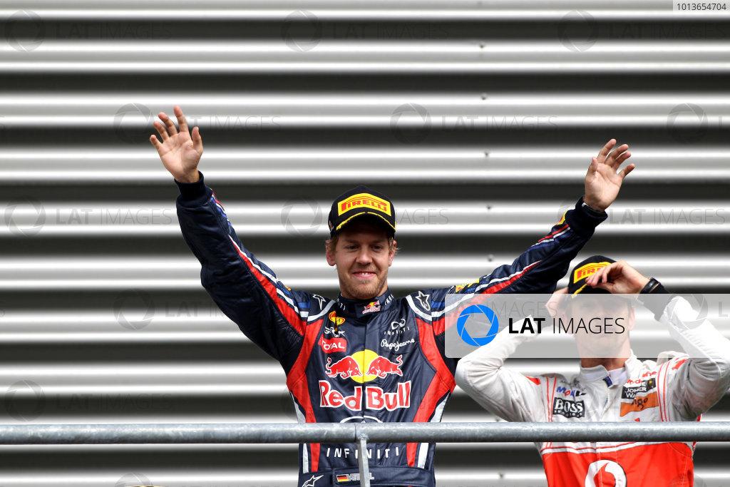 Spa-Francorchamps, Spa, Belgium28th August 2011.Sebastian Vettel, Red Bull Racing RB7 Renault, 1st position, arrives on the podium. Portrait. Podium. World Copyright: Andy Hone/LAT Photographicref: Digital Image CI0C2420