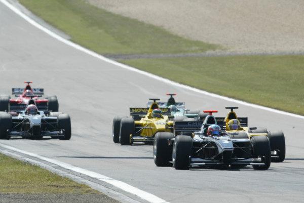 2004 Formula 3000 Championship (F3000) Nurburgring, Germany.29th May 2004. Jose Maria Lopez (CMS Performance) leads Patrick Friesacher (Super Nova Racing) and Alan van der Merwe (Super Nova Racing). Action.World Copyright: LAT Photographic ref: Digital Image Only