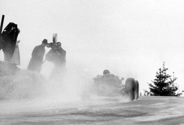 1966 Belgian Grand Prix.Spa-Francorchamps, Belgium. 12 June 1966.Cameramen in the rain and mist, atmosphere, action.World Copyright: LAT PhotographicRef: b&w print