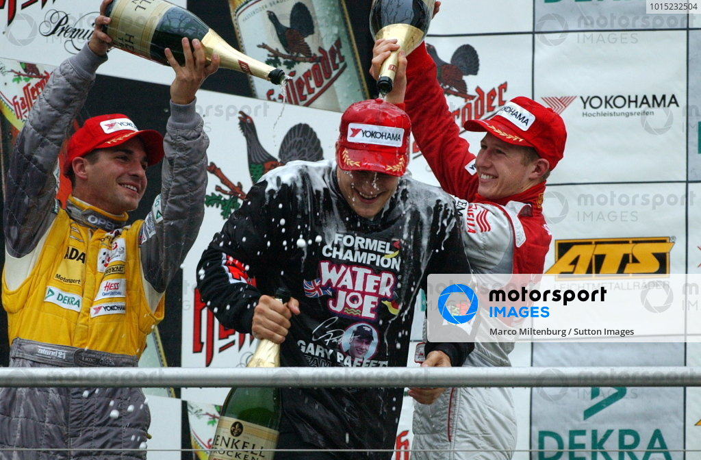 Race winner and 2002 champion Gary Paffett (GBR), Team Rosberg, centre, gets a champagne shower from second placed Timo Glock (GER), left, Opel Team KMS,  and third placed Ryan Briscoe (AUS), right, Prema Powerteam.