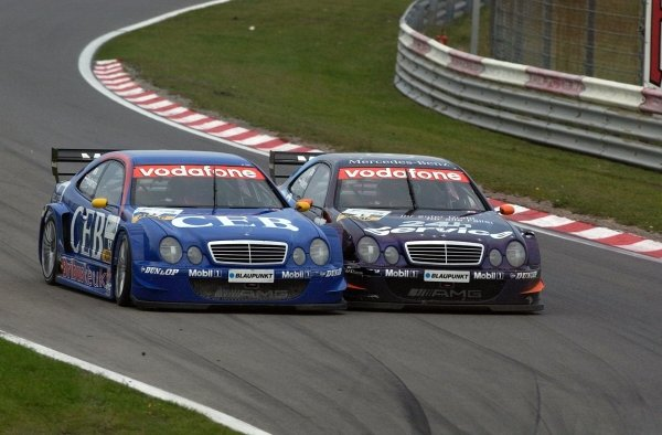 Fellow Dutchmen Patrick Huisman CEB AMG-Mercedes CLK , left, and Christijan Albers, Service 24h AMG-Mercedes CLK, right, collide.