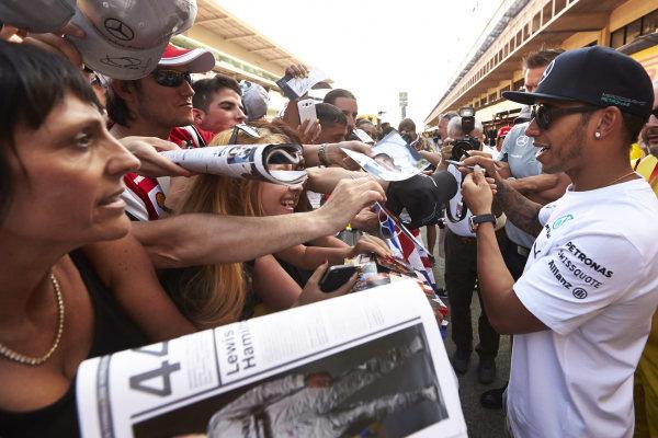 Circuit de Catalunya, Barcelona, Spain. Thursday 8 May 2014. Lewis Hamilton, Mercedes AMG, signs autographs for fans. World Copyright: Steve EtheringtonLAT Photographic. ref: Digital Image SNE11750 copy