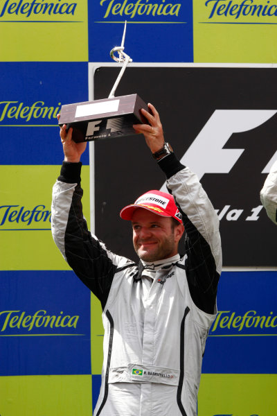Circuit de Catalunya, Barcelona, Spain 10th May 2009 Rubens Barrichello, Brawn GP BGP001 Mercedes, 2nd position, lifts his trophy on the podium. Portrait. Podium.  World Copyright: Andrew Ferraro/LAT Photographic ref: Digital Image _H0Y6199