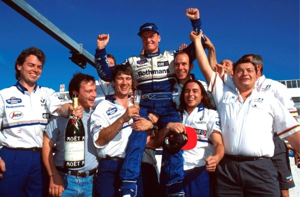 David Coulthard (GBR) Williams celebrates his first Grand Prix victory with members of the Williams team. Portuguese Grand Prix, Estoril, 24 September 1995.