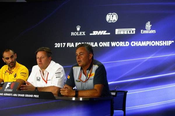 Yas Marina Circuit, Abu Dhabi, United Arab Emirates. Friday 24 November 2017. Cyril Abiteboul, Managing Director, Renault Sport F1, Zak Brown, Executive Director, McLaren Technology Group, and Mario Isola, Racing Manager, Pirelli Motorsport, in the press conference. World Copyright: Andy Hone/LAT Images  ref: Digital Image _ONZ9415