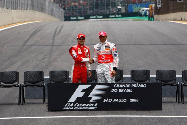Interlagos, Sao Paulo, Brazil2nd November 2008Lewis Hamilton, McLaren MP4-23 Mercedes, and Felipe Massa, Ferrari F2008, shake hands before the battle commences on track. Portrait. World Copyright: Andrew Ferraro/LAT Photographicref: Digital Image _H0Y9497