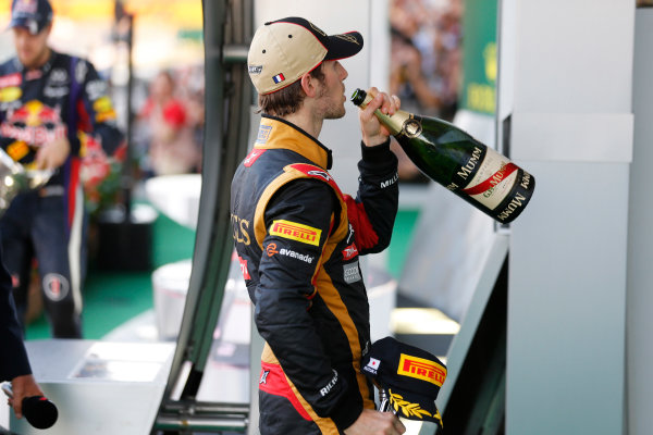 Suzuka Circuit, Suzuka, Japan.  Sunday 13th October 2013. Romain Grosjean, Lotus F1, 3rd position, drinks some Champagne on the podium.  World Copyright: Steven Tee/LAT Photographic  ref: Digital Image _C3I1193