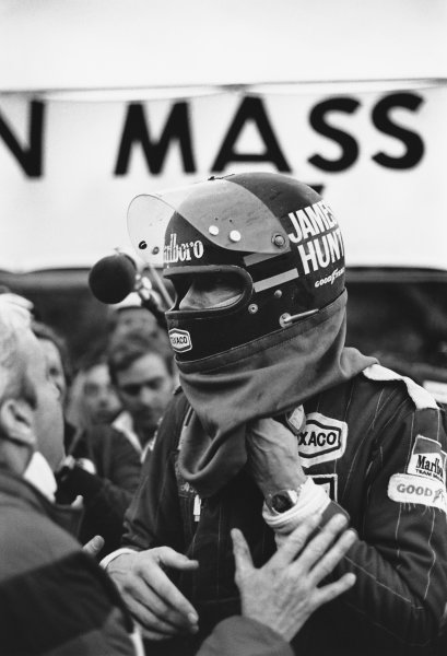 Fuji, Japan. 22nd - 24th October 1976. James Hunt (McLaren M23-Ford), 3rd position, is told bt Teddy Mayer that he has won the World Drivers title, portrait.  World Copyright: LAT Photographic.  Ref: 9287 - 35A.
