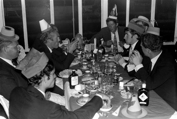 Drivers and team personnel enjoy a New Year's Eve celebration. Amongst the revellers are Jochen Rindt (AUT) (top right), Jackie Stewart (GBR) (centre right), Jacky Ickx (BEL) (Bottom Left) and Colin Chapman (Centre Left). 