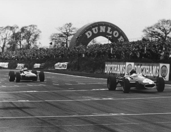 Brands Hatch, England. 12th March 1967.Dan Gurney (Eagle T1G-Weslake), 1st position, leads Lorenzo Bandini (Ferrari 312), 2nd position, action. World Copyright: LAT Photographic.Ref: B/W Print.