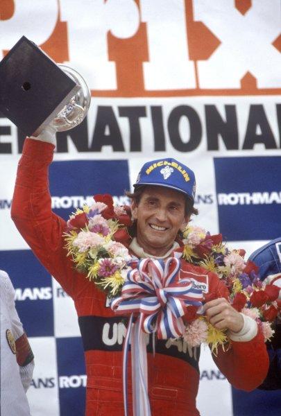 1982 Detroit Grand Prix.Detroit, United States. 6 June 1982.John Watson, McLaren MP4/1B-Ford, 1st position, podium.World Copyright: LAT PhotographicRef: 35mm transparency 82USA16