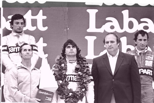 1982 Canadian Grand Prix. Montreal, Canada. 11-13 June 1982. Nelson Piquet (Brabham BT50-BMW), 1st position, Riccardo Patrese (Brabham BT49D-Ford Cosworth), 2nd position and John Watson (McLaren MP4/1B-Ford Cosworth), 3rd position on the podium with Gilles Villeneuve father, Seville, holding the winners trophy. World Copyright: LAT Photographic Ref: 82/691/19A-20.