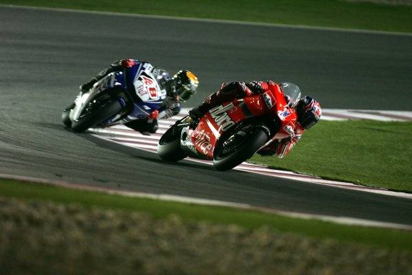 2008 MotoGP. Losail, Qatar. 7th - 9th March 2008. Rd 1. Casey Stoner, Ducati, 1st position, leads Jorge Lorenzo, Yamaha, 2nd position, action. World Copyright: Martin Heath/LAT Photographic. Ref: Digital Image Only.