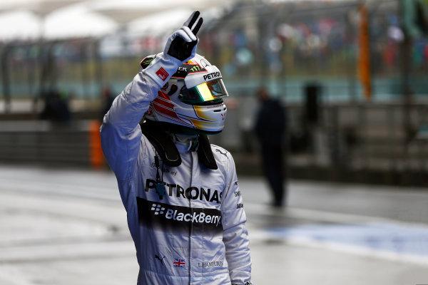 Shanghai International Circuit, Shanghai, China. Saturday 19 April 2014. Lewis Hamilton, Mercedes AMG, celebrates pole in Parc Ferme. World Copyright: Andy Hone/LAT Photographic. ref: Digital Image _ONZ5305