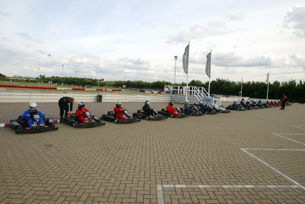 The competitors line up in the pits before the start of qualifying.  Sutton Motorsport Images Annual Karting Grand Prix; Daytona International Raceway, Milton Keynes, England, 24 July 2003.DIGITAL IMAGE