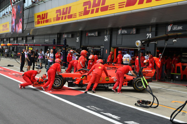 Charles Leclerc, Ferrari SF90, is returned to the garage