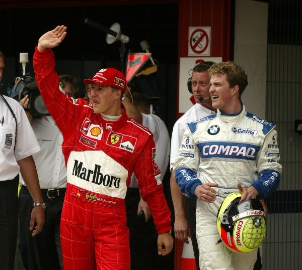 2002 Spanish Grand Prix - QualifyingBarcelona, Spain. 27th April 2002Michael Schumacher with brother Ralf after the Ferrari driver takes pole position in the final minutes of the qualifying session.World Copyright: Steve Etherington/LATref: Digital Image Only
