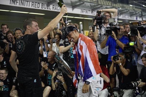 Lewis Hamilton celebrates with the Mercedes team.