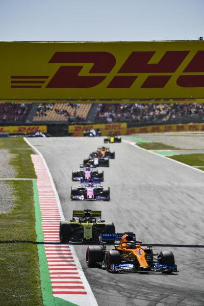 Carlos Sainz Jr., McLaren MCL34, leads Daniel Ricciardo, Renault R.S.19, Sergio Perez, Racing Point RP19, and Lance Stroll, Racing Point RP19
