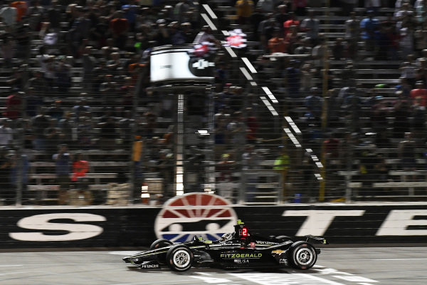 Josef Newgarden, Team Penske Chevrolet crosses the finish line under the checkered flag for the win