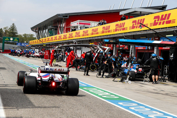 Nikita Mazepin, Haas VF-21, passes Fernando Alonso, Alpine A521, in the pits