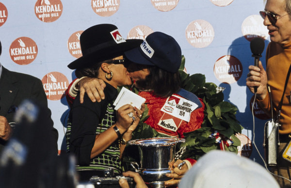 Emerson Fittipaldi celebrates his second world championship on the podium with wife Maria-Helena.