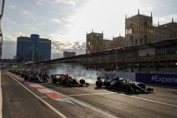 Sir Lewis Hamilton, Mercedes W12 runs wide from Sergio Perez, Red Bull Racing RB16B at the restart of the race