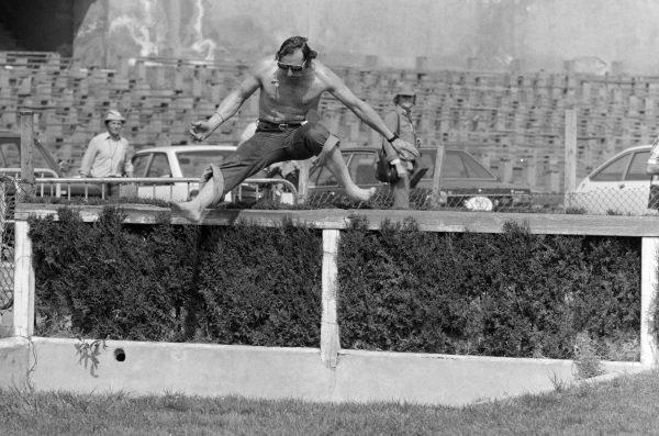 Vittorio Brambilla jumps a partition.