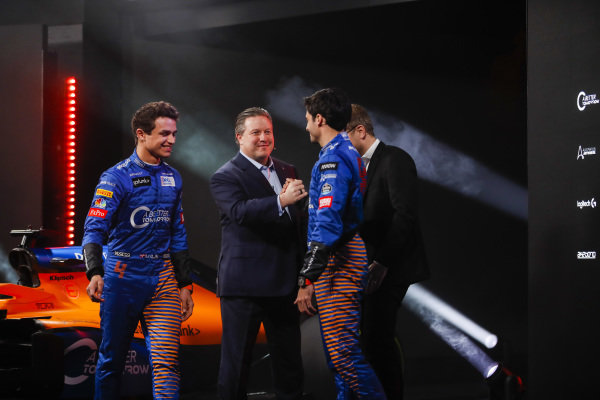 Lando Norris, McLaren, and Carlos Sainz Jr, McLaren, are greeted by Zak Brown, CEO, McLaren Racing, and Andreas Seidl, Team Principal, McLaren