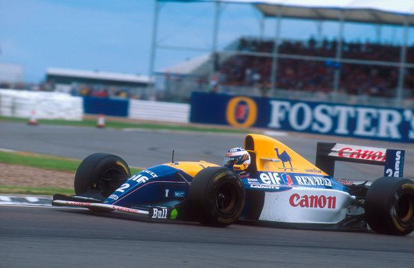 1993 British Grand Prix. Silverstone, England. 9-11 July 1993. Alain Prost (Williams FW15C Renault) 1st position. Ref-93 GB 06. World Copyright - LAT Photographic