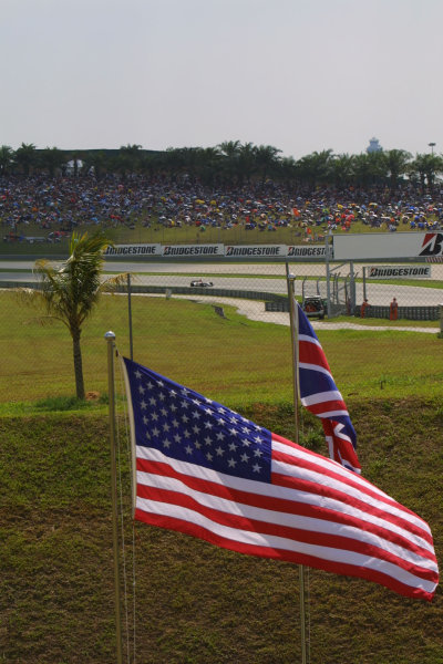 2003 Malaysian Grand Prix. Sepang, Kuala Lumpur, Malaysia.21-23 March 2003.The U S. and British flags with a B.A R. 005 Honda passing by behind.World Copyright - LAT Photographic ref: Digital Image Only