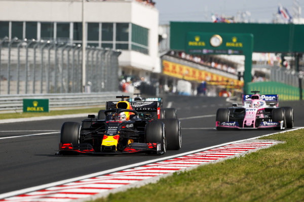 Max Verstappen, Red Bull Racing RB15, leads Lewis Hamilton, Mercedes AMG F1 W10, and Sergio Perez, Racing Point RP19