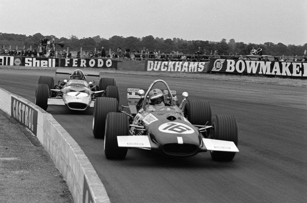 Piers Courage, Brabham BT26A Ford, leads Graham Hill, Lotus 49B Ford.
