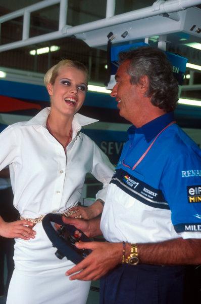 Barcelona, Spain. 12-14 May 1995. Benetton team boss Flavio Briatore with model Eva Herzigova.  Ref-95 ESP 15. World Copyright - LAT Photographic