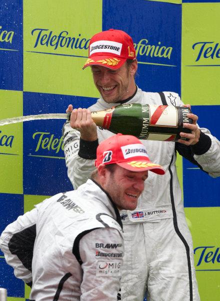 Circuit de Catalunya, Barcelona, Spain 10th May 2009 Jenson Button, Brawn GP BGP001 Mercedes, 1st position, and Rubens Barrichello, Brawn GP BGP001 Mercedes, 2nd position, celebrate on the podium. Portrait. Podium.  World Copyright: Steve Etherington/LAT Photographic ref: Digital Image SNE13989