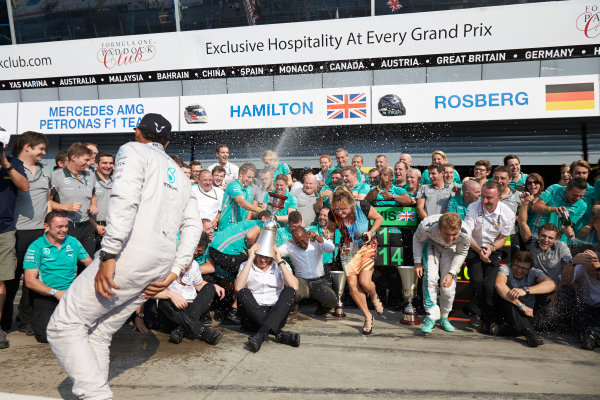 Autodromo Nazionale di Monza, Monza, Italy. Sunday 7 September 2014. Lewis Hamilton, Mercedes AMG, 1st Position, Nico Rosberg, Mercedes AMG, 2nd Position, Toto Wolff, Executive Director (Business), Mercedes AMG, Paddy Lowe, Executive Director (Technical), Mercedes AMG, and the Mercedes AMG team celebrate.  World Copyright: Steve Etherington/LAT Photographic. ref: Digital Image SNE15880