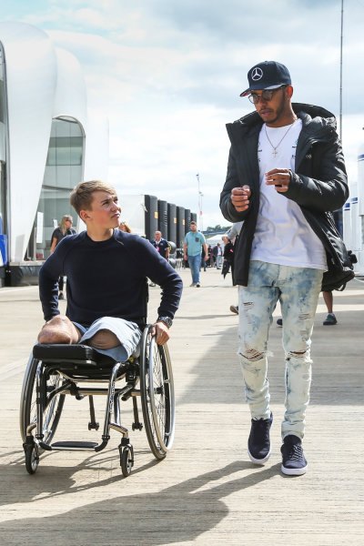 Silverstone, Northamptonshire, UK.  Friday 14 July 2017. Lewis Hamilton, Mercedes AMG, talks with racing driver Billy Monger. World Copyright: Charles Coates/LAT Images  ref: Digital Image AN7T7434