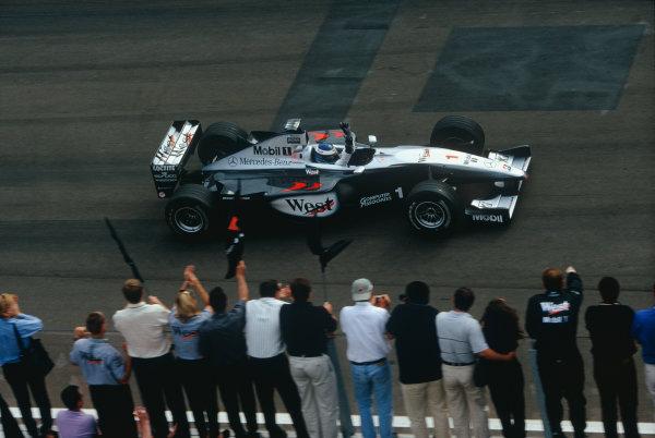 Hungaroring, Budapest, Hungary. 13-15 August 1999. Mika Hakkinen (McLaren MP4/14 Mercedes-Benz) celebrates victory at the finish. Action. Ref: 99 HUN 09. World Copyright - LAT Photographic