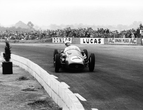 Silverstone, England. 14th July 1956.Stirling Moss (Maserati 250F), 8th position, action. World Copyright: LAT Photographic.Ref: 599 - 10.
