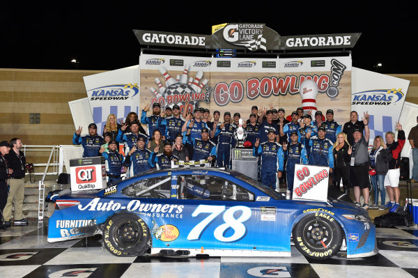 Monster Energy NASCAR Cup Series Go Bowling 400 Kansas Speedway, Kansas City, KS USA Sunday 14 May 2017 Martin Truex Jr, Furniture Row Racing, Auto-Owners Insurance Toyota Camry celebrates his win in Victory Lane World Copyright: Nigel Kinrade LAT Images ref: Digital Image 17KAN1nk09829
