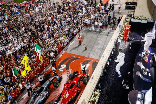 Bahrain International Circuit, Sakhir, Bahrain.  Sunday 16 April 2017. Sebastian Vettel, Ferrari, 1st Position, Valtteri Bottas, Mercedes AMG, 3rd Position, and Lewis Hamilton, Mercedes AMG, 2nd Position, celebrate on the podium. World Copyright: Steven Tee/LAT Images ref: Digital Image _O3I7727