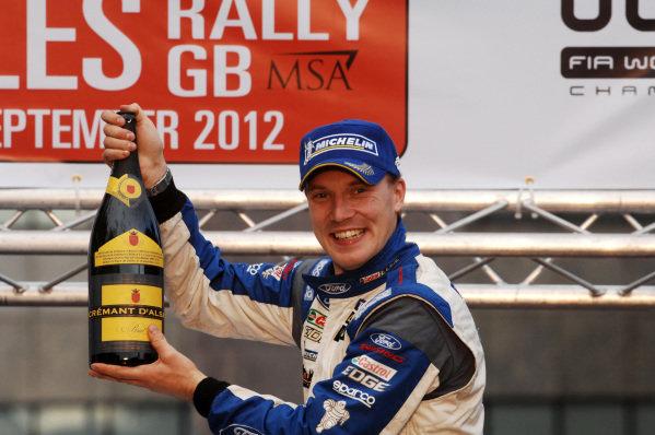 Jari-Matti Latvala (FIN) celebrates victory on the podium.FIA World Rally Championship, Rd10, Wales Rally GB, Day Three, Cardiff, Wales, 16 September 2012.