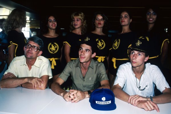 A Lotus press conference for the first race of the season (L to R): Peter Warr (GBR) Lotus Team Manager; Ayrton Senna (BRA), who took pole position and finished second in the race; and team mate Johnny Dumfries (GBR) Lotus, who finished ninth on his GP debut.