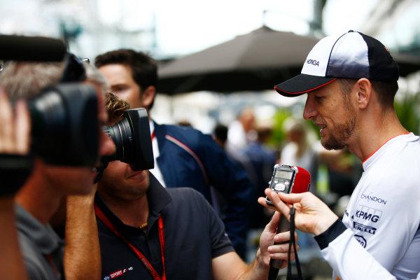 Interlagos, Sao Paulo, Brazil. Thursday 10 November 2016. Jenson Button, McLaren, is interviewed by Davide Valsecchi of Sky Italia. World Copyright: Andrew Hone/LAT Photographic ref: Digital Image _ONZ4255