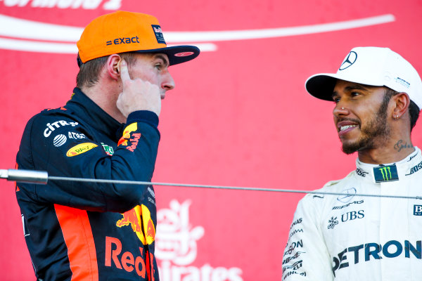 Suzuka Circuit, Japan. Sunday 8 October 2017. Max Verstappen, Red Bull, 2nd Position, and Lewis Hamilton, Mercedes AMG, 1st Position, on the podium. World Copyright: Charles Coates/LAT Images  ref: Digital Image DJ5R1519