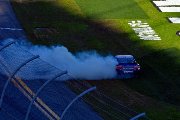 "13-21 February, 2016, Daytona Beach, Florida USA Daytona 500 winner Denny Hamlin, FedEx Express Toyota Camry celebrates by doing doughnuts in the ""ballfield"". ?2016, F. Peirce Williams LAT Photo USA"