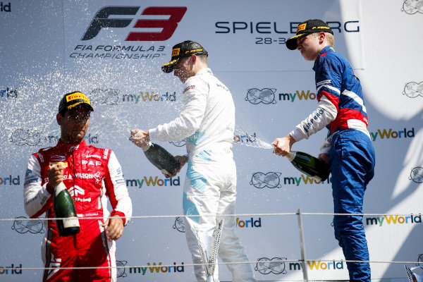 Race winner Jake Hughes (GBR) HWA RACELAB, Second place Jehan Daruvala (IND) PREMA Racing and third place Robert Shwartzman (RUS) PREMA Racing on the podium with the champagne