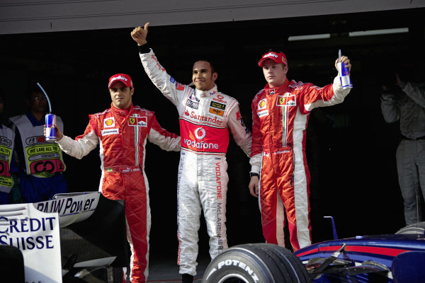 The Top 3 of qualifying: Pole sitter Lewis Hamilton in the middle, 2nd placed Kimi Raikkonen on the right hand and 3rd placed Felipe Massa on the left.