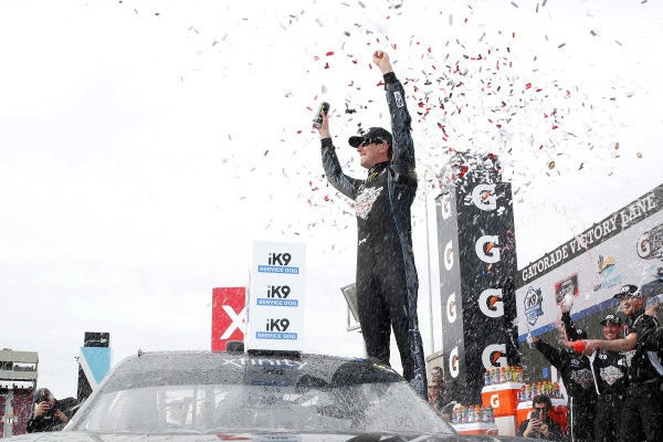 #18: Kyle Busch, Joe Gibbs Racing, Toyota Supra Extreme Concepts/iK9celebrates in victory lane